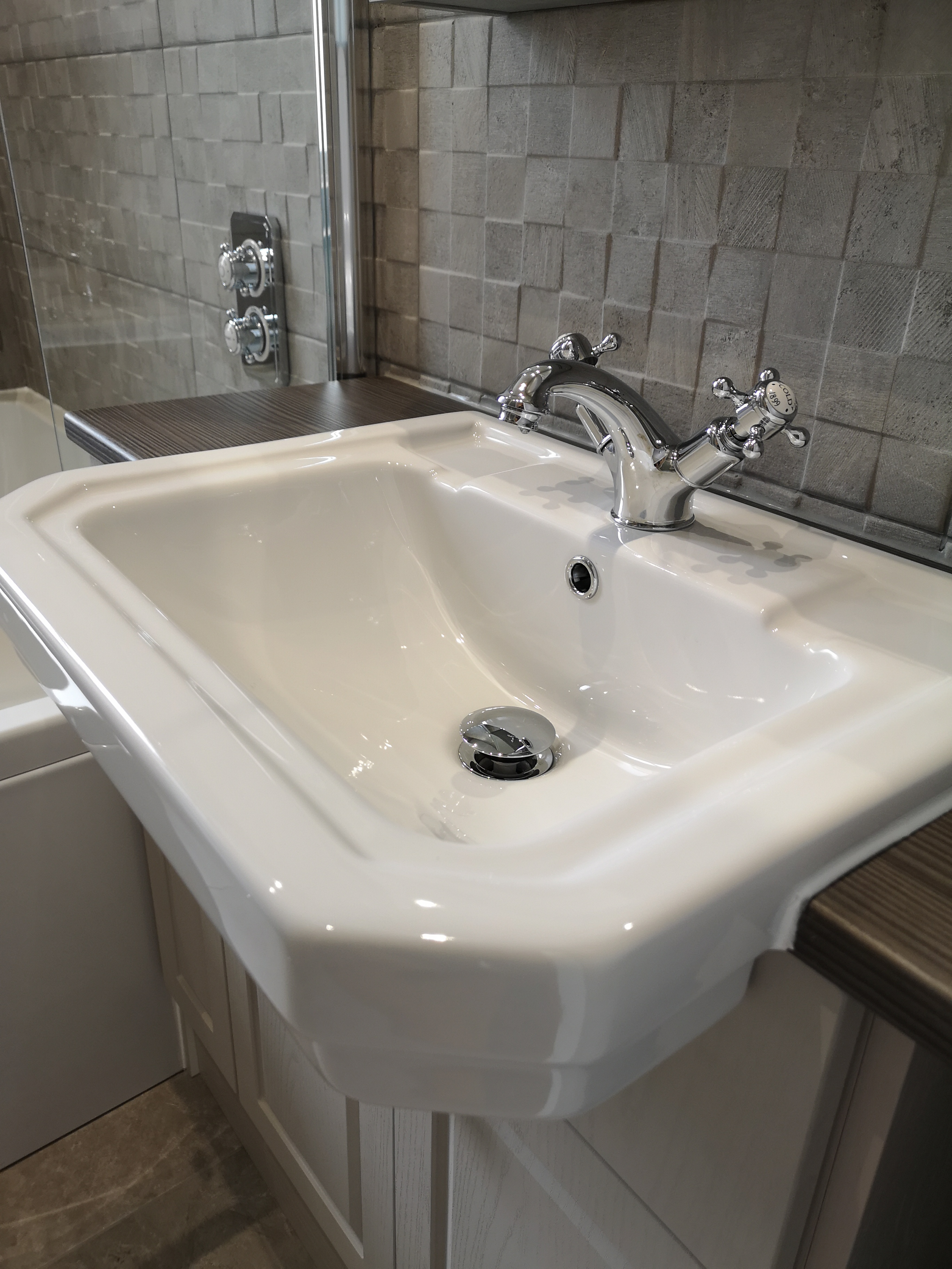 porcelanosa tiles with mosaic texture splashback for traditional sink