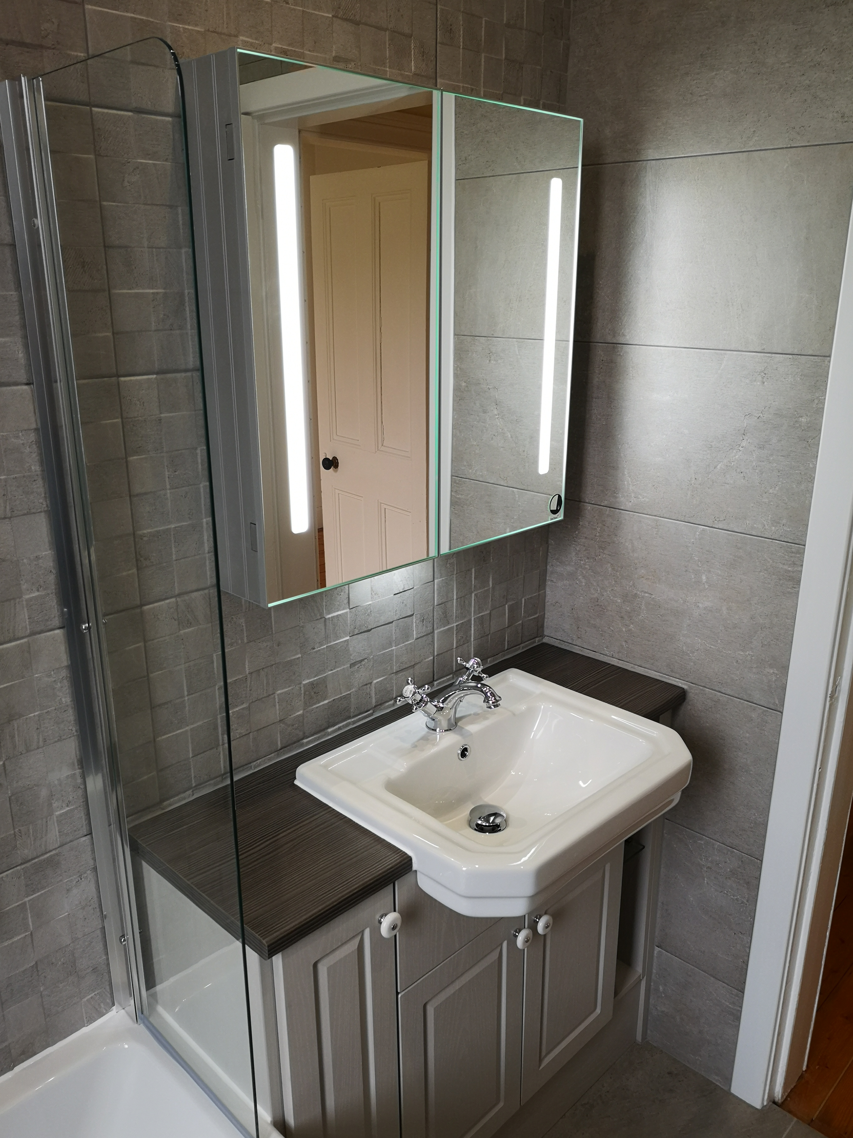porcelanosa tiles with mosaic texture as feature wall for traditional style vanity unit