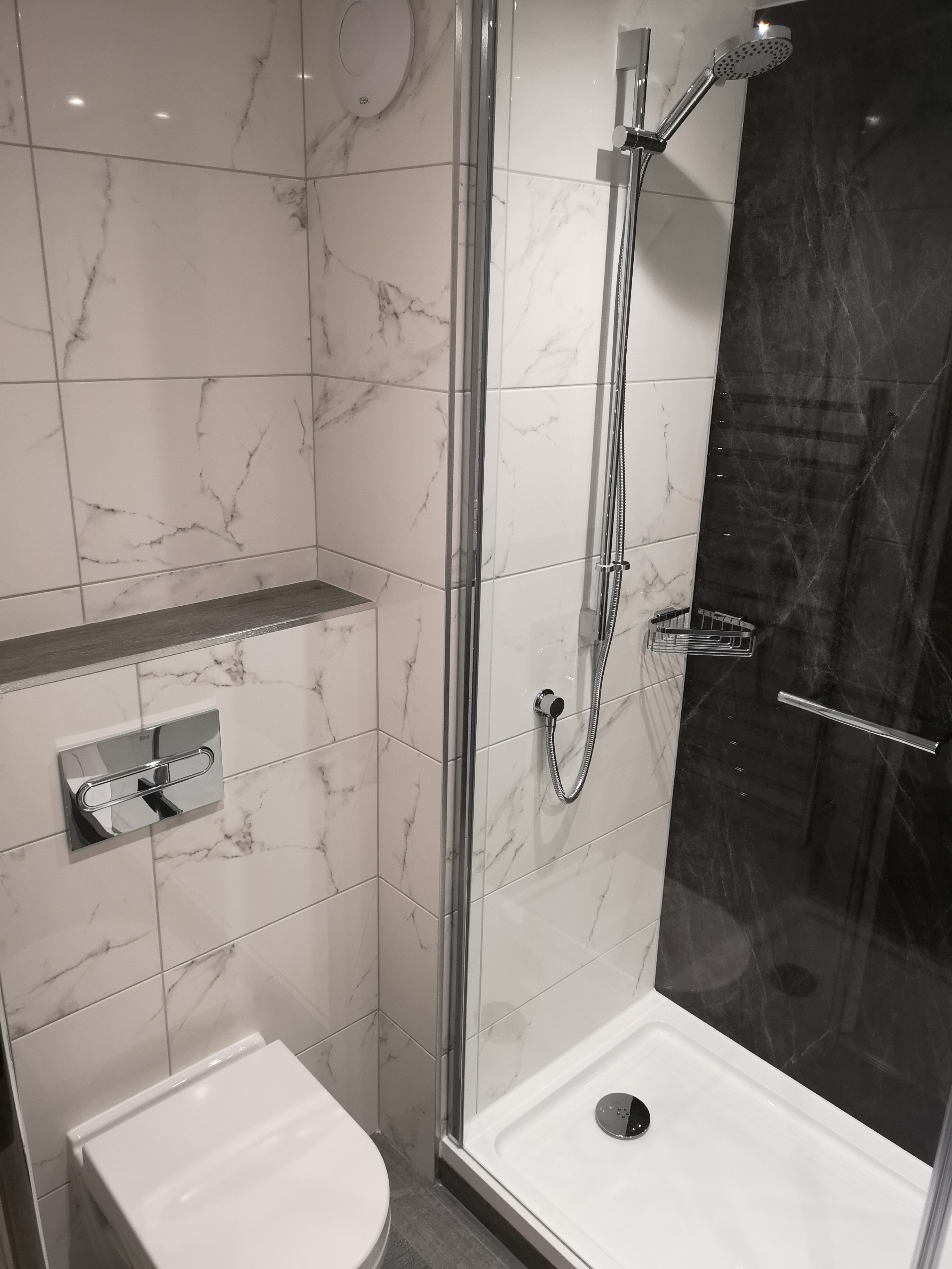 Bulkhead for concealed cistern with marble tiles