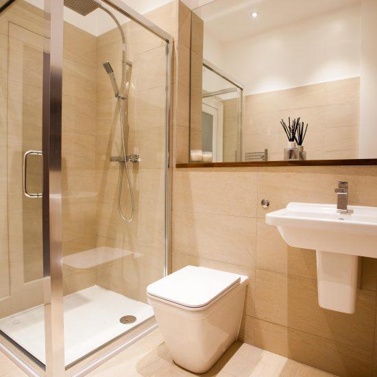 Beige shower room Mortonhall Road Edinburgh Bathroom with copper bath