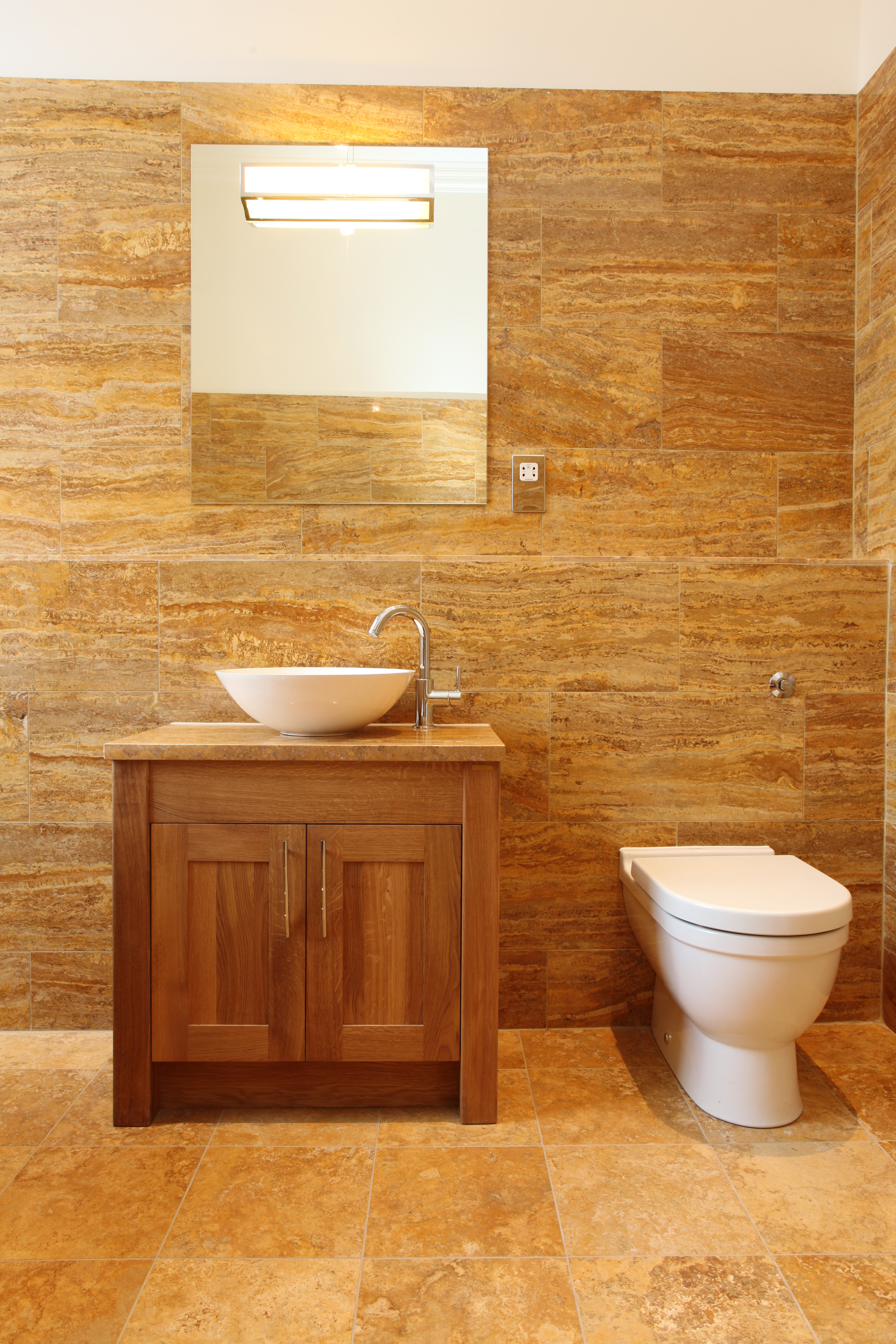 Traditional oak shaker vanity unit with deck mounted basin and tap design in Edinburgh