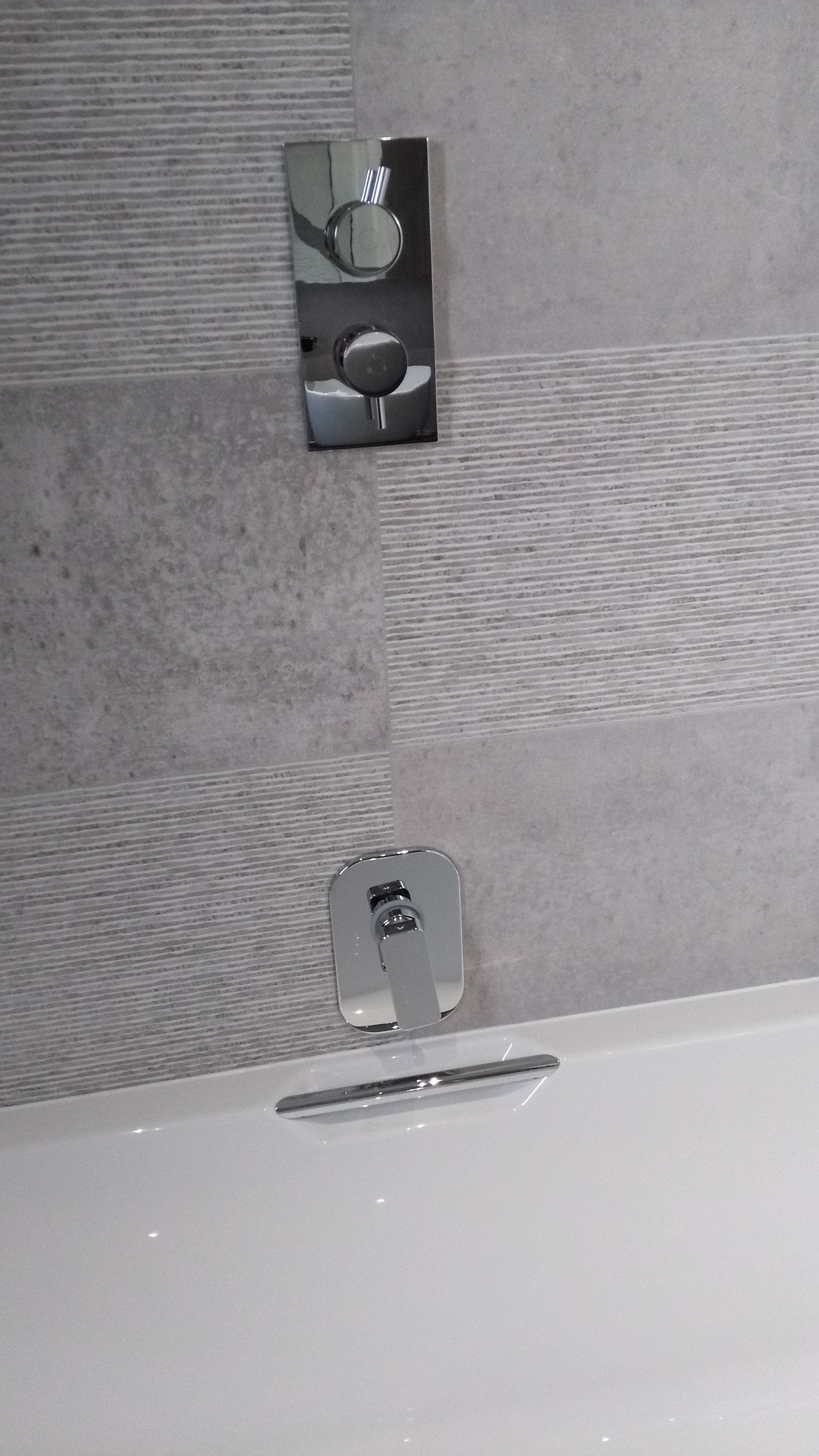Porcelanosa Large Format Grey Tiles with wall mouted bath tap