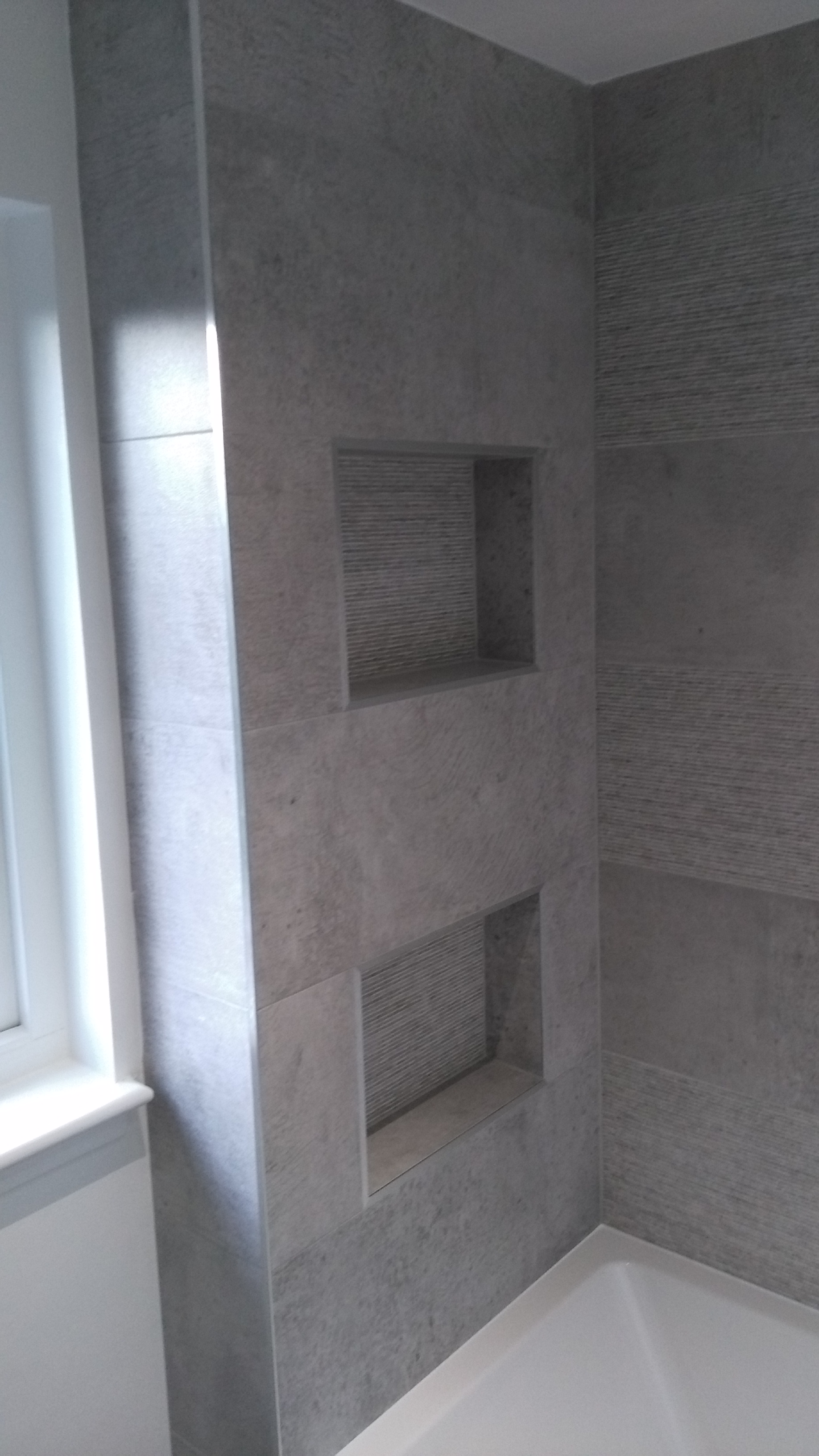 Large format Porcelanosa tiles with box displays