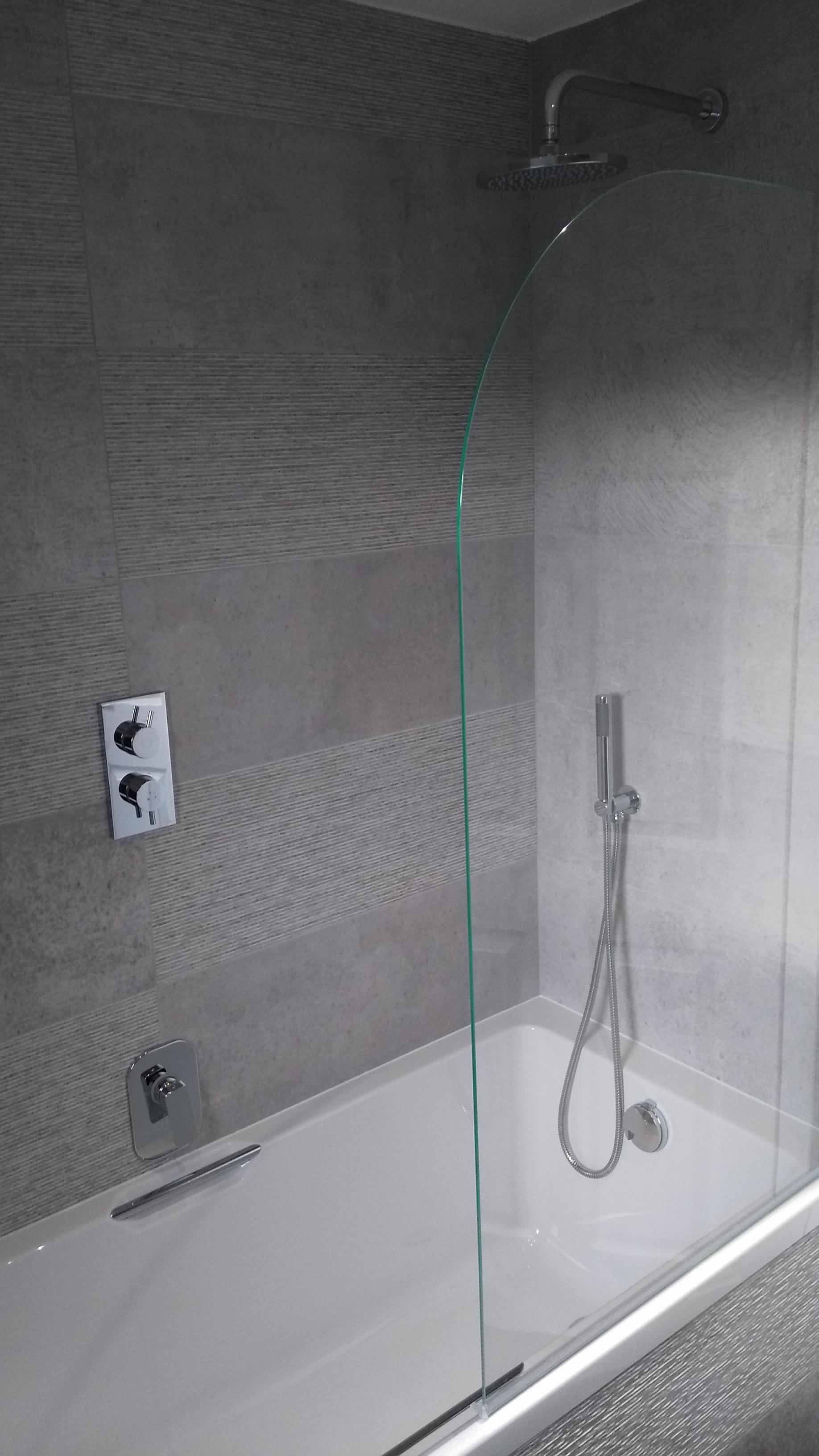 Large format Porcelanosa tile in grey shower