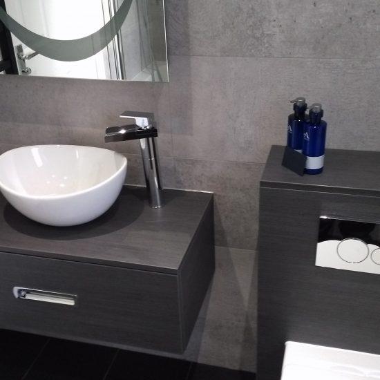 Large format tiles and dark wood vanity unit in Edinburgh Bathroom Design