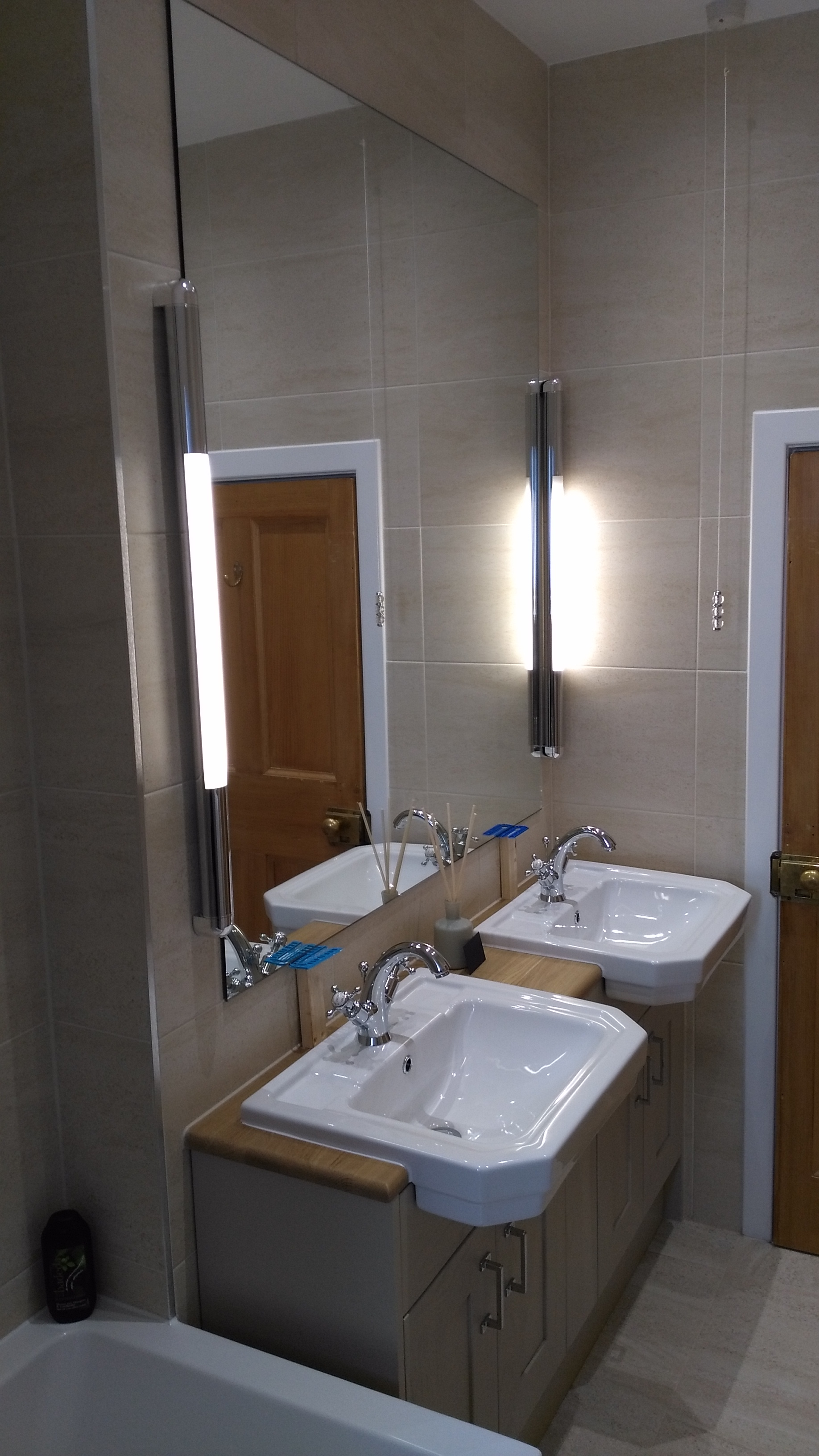 Twin sink bathroom with larger mirror
