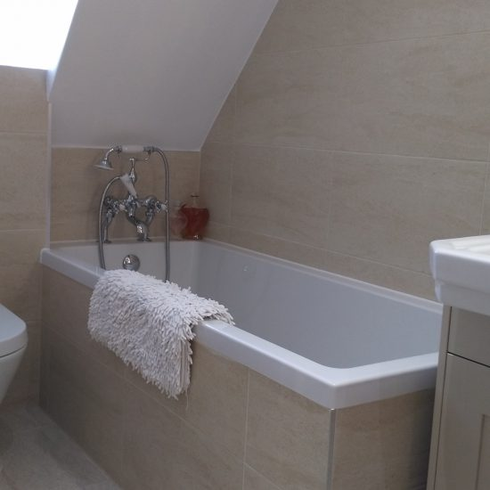 Pointgarry Road double sinks with large vanity unit and tiled in bath