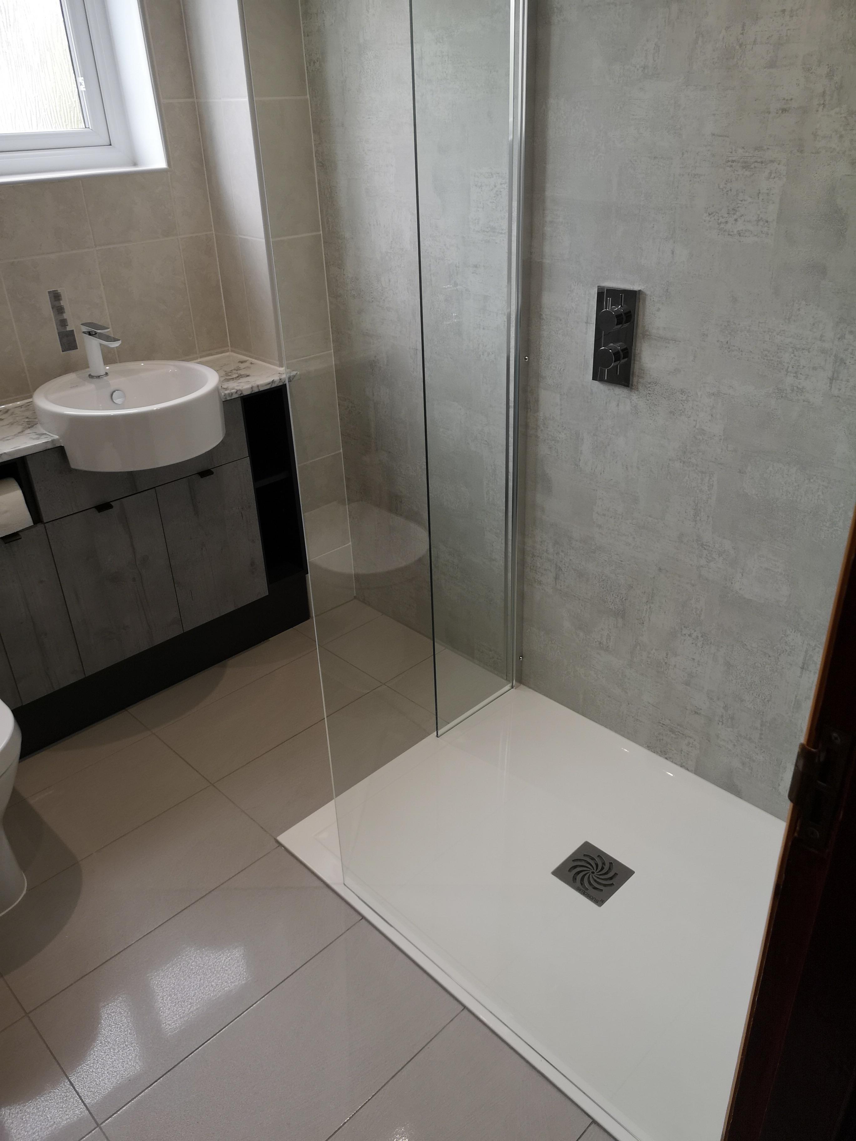 Grey Bathroom gloss wall and floor tiles with bespoke glass