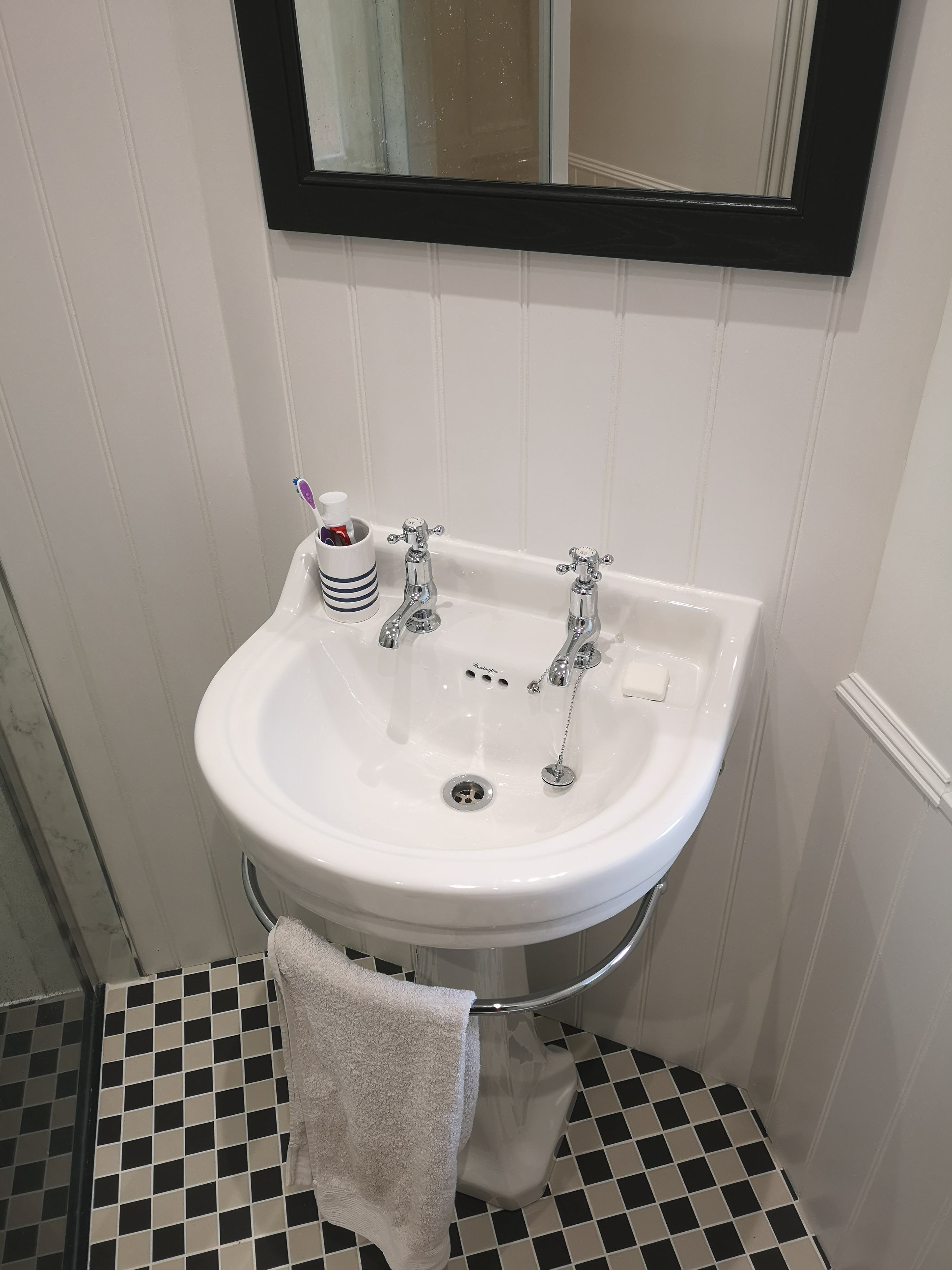 Traditional Bathroom Sink with separate hot and cold taps with towel rail.