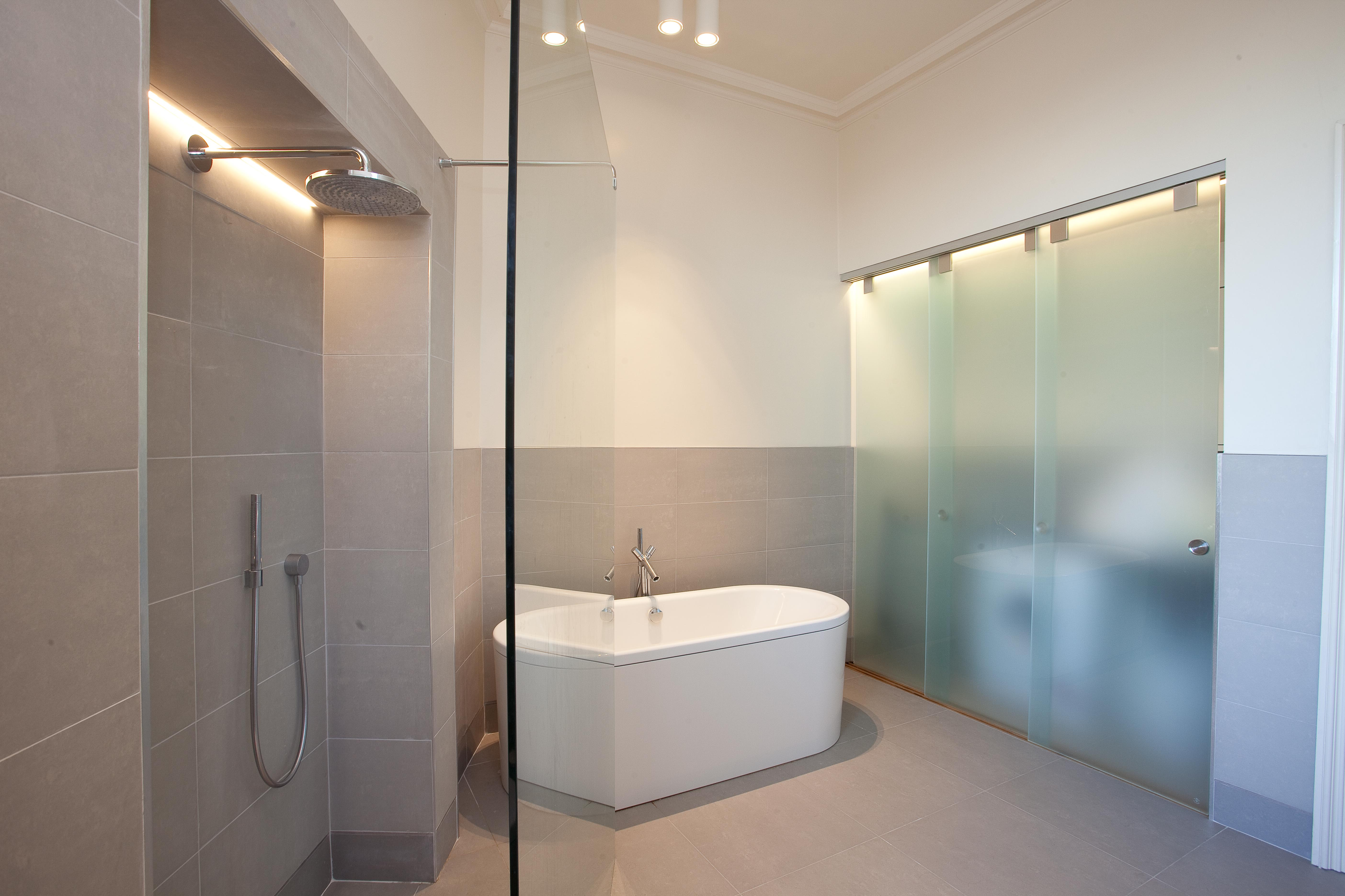 Freestanding bath with wall mounted contemporary tap.