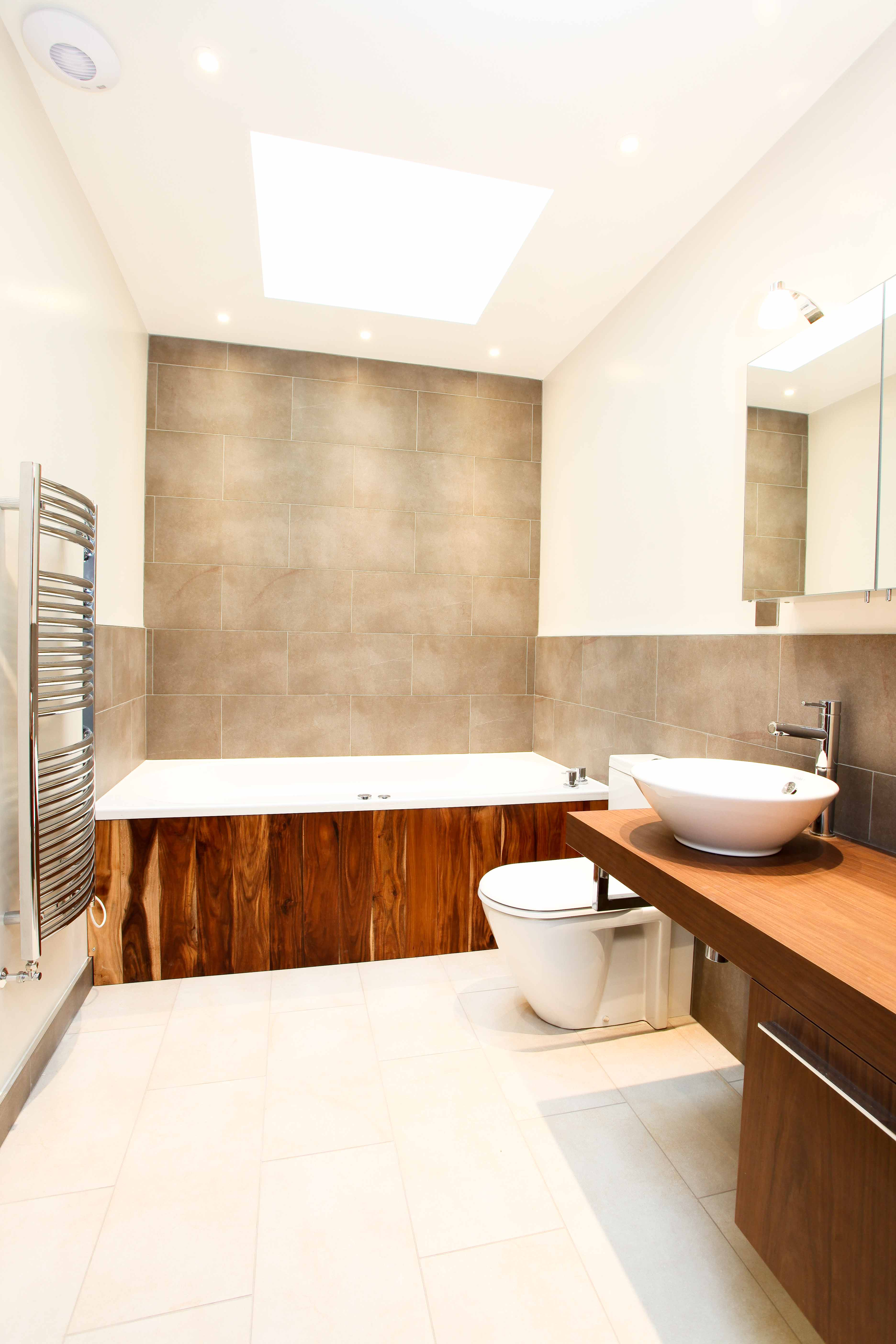 Large bathroom with wood panel toilet and basin