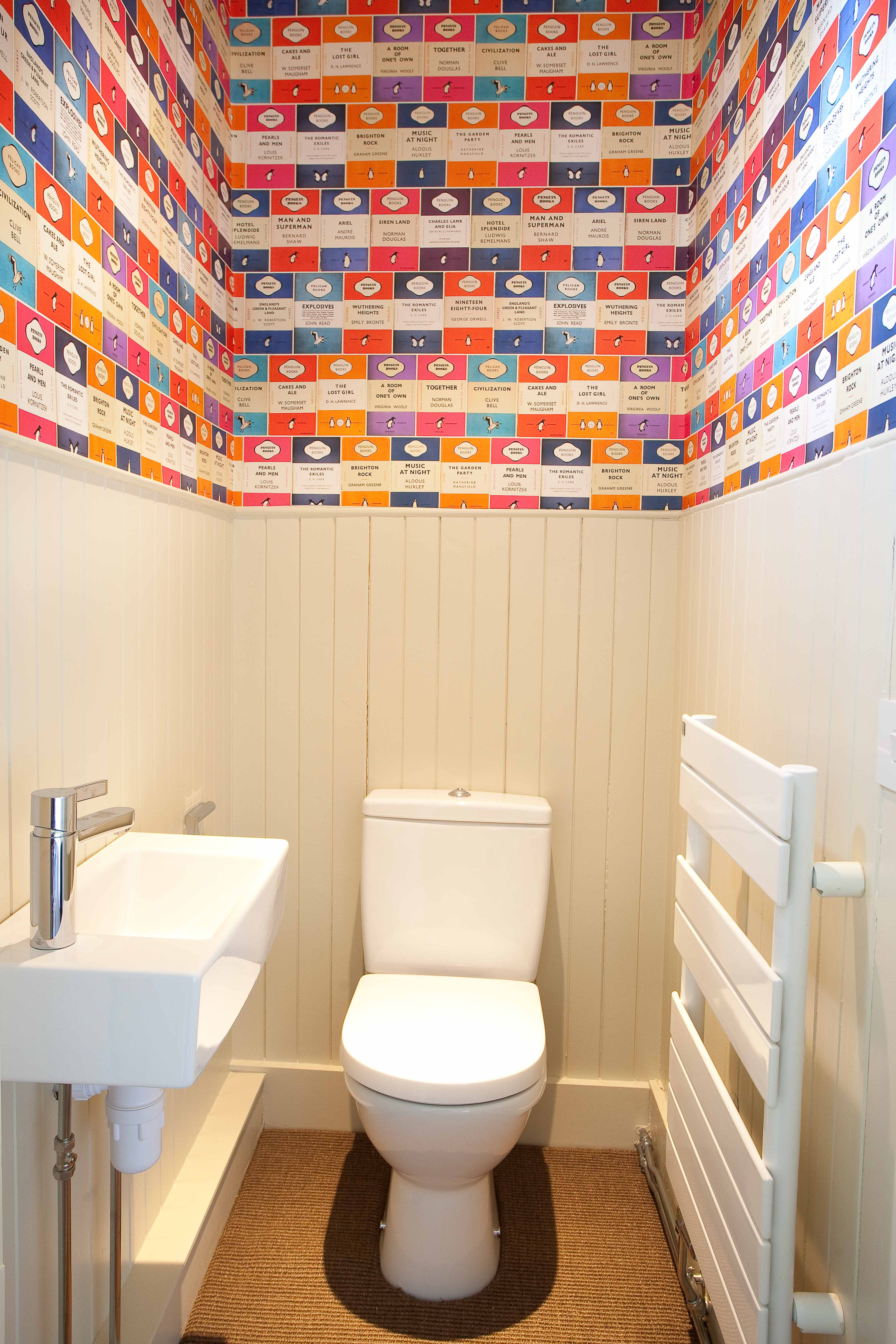Small Edinburgh Bathroom Design with timber wall panelling and bright wallpaper