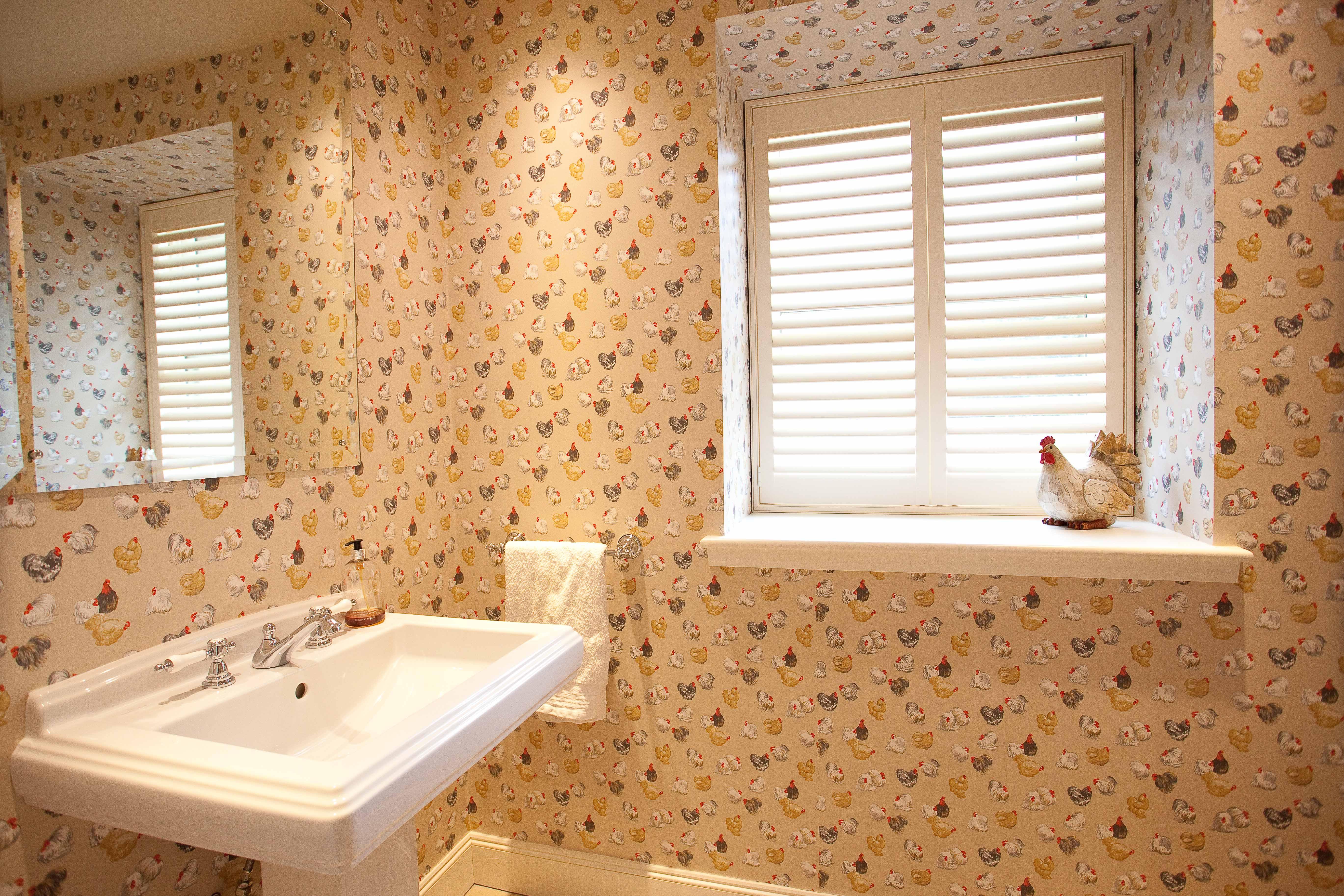 Edinburgh bathroom design with wallpaper wall and large pedesal basin