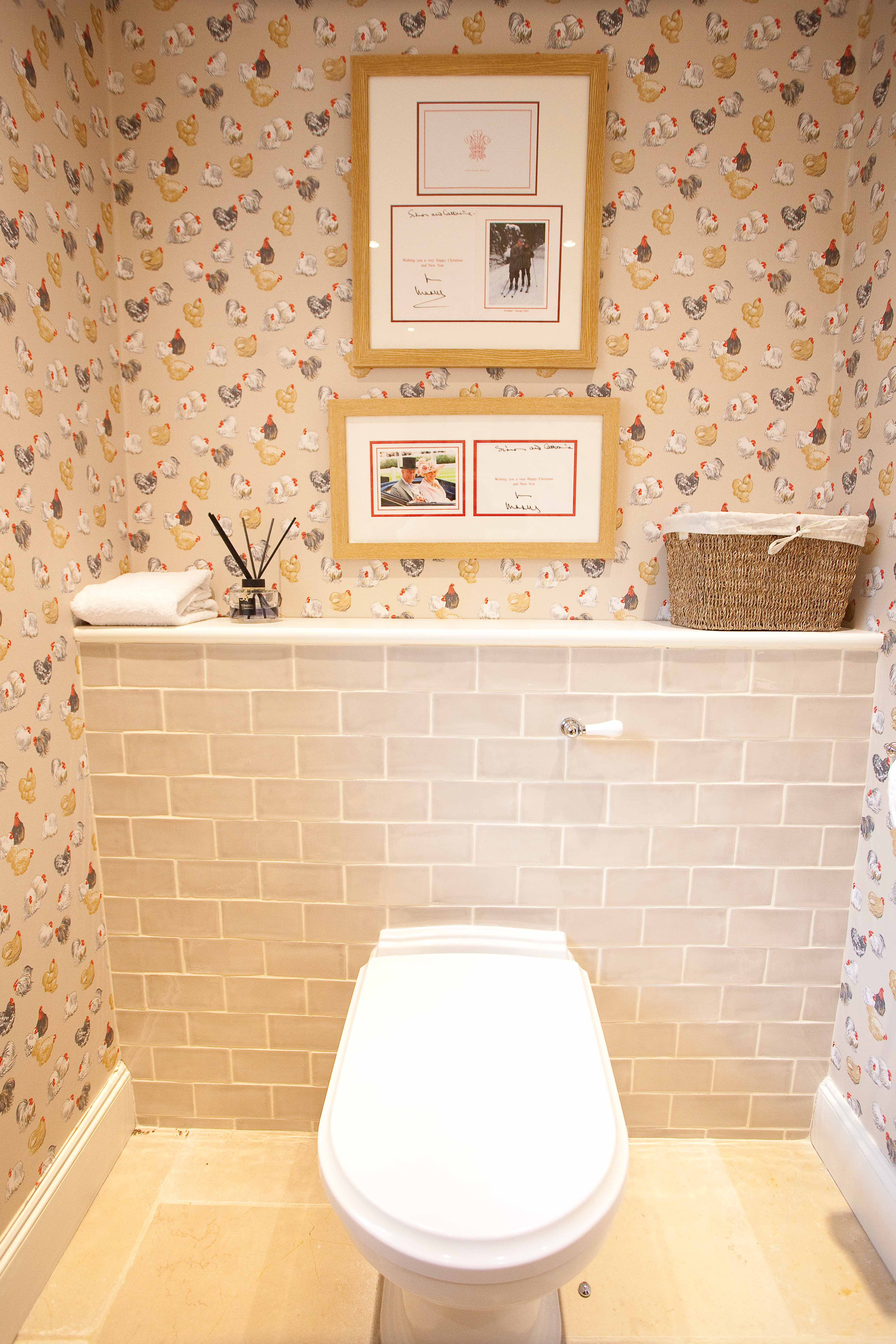 Concealed Cistern Toilet with subway tile bulkhead.