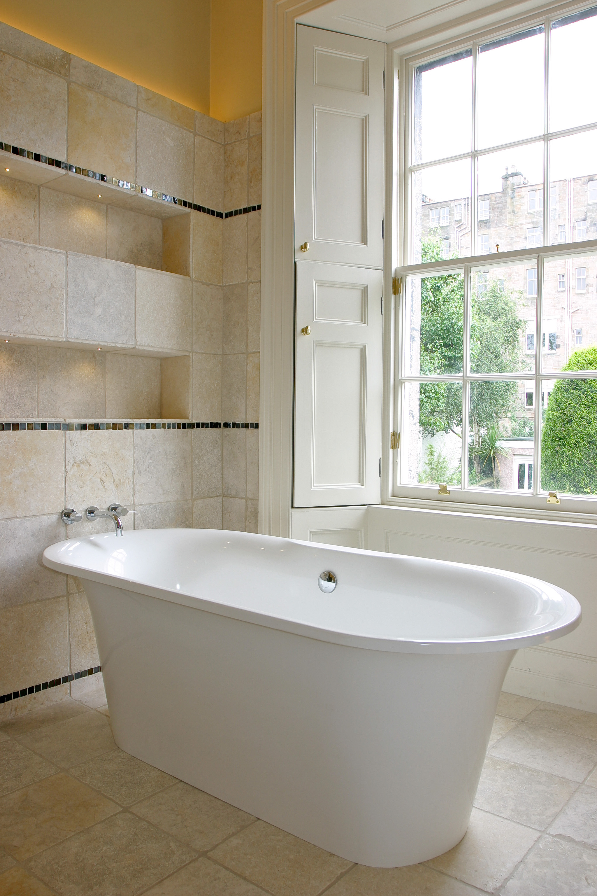 Rolltop bath in traditional home and wall mounted taps