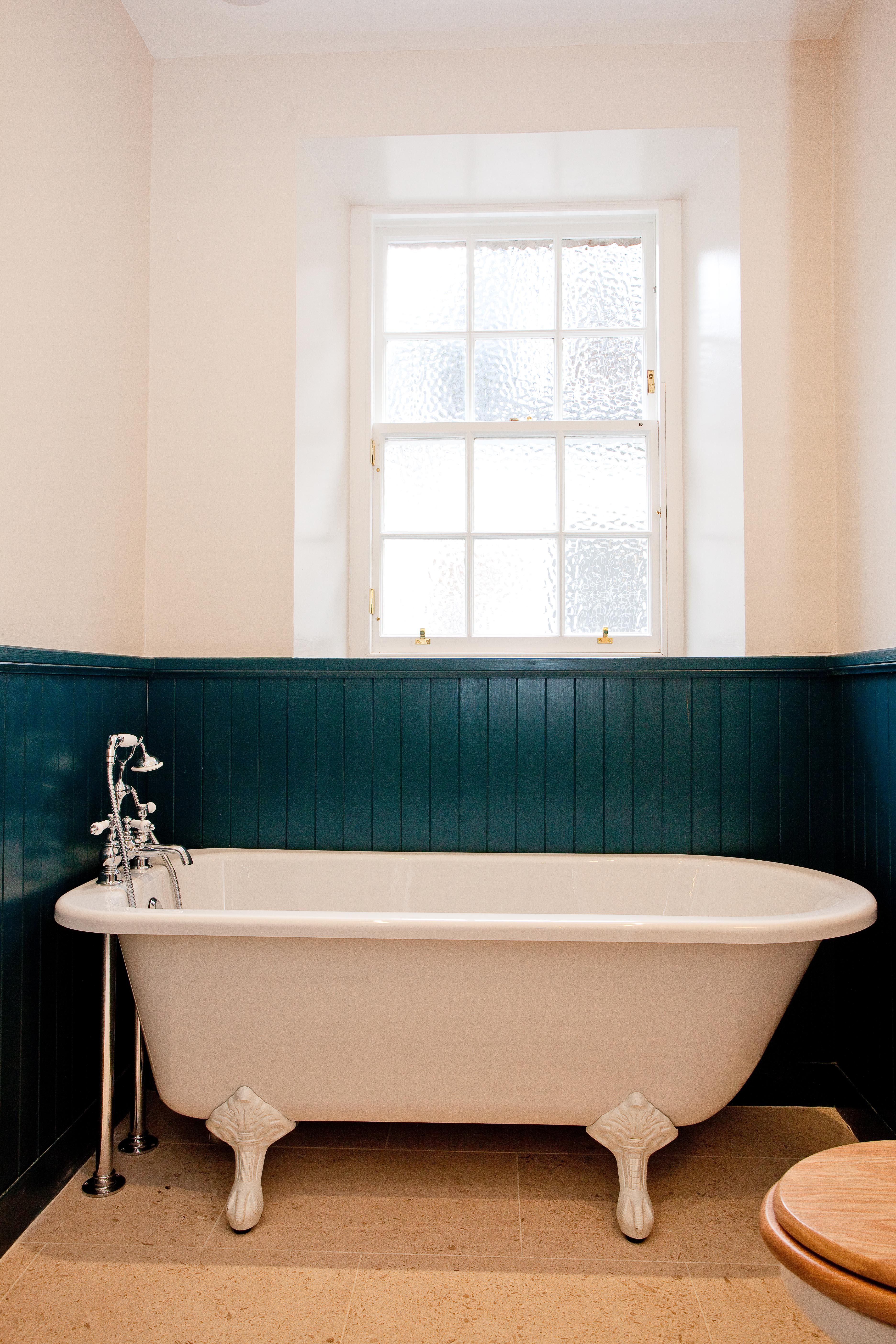 Traditional roll top bath with floor standing tap