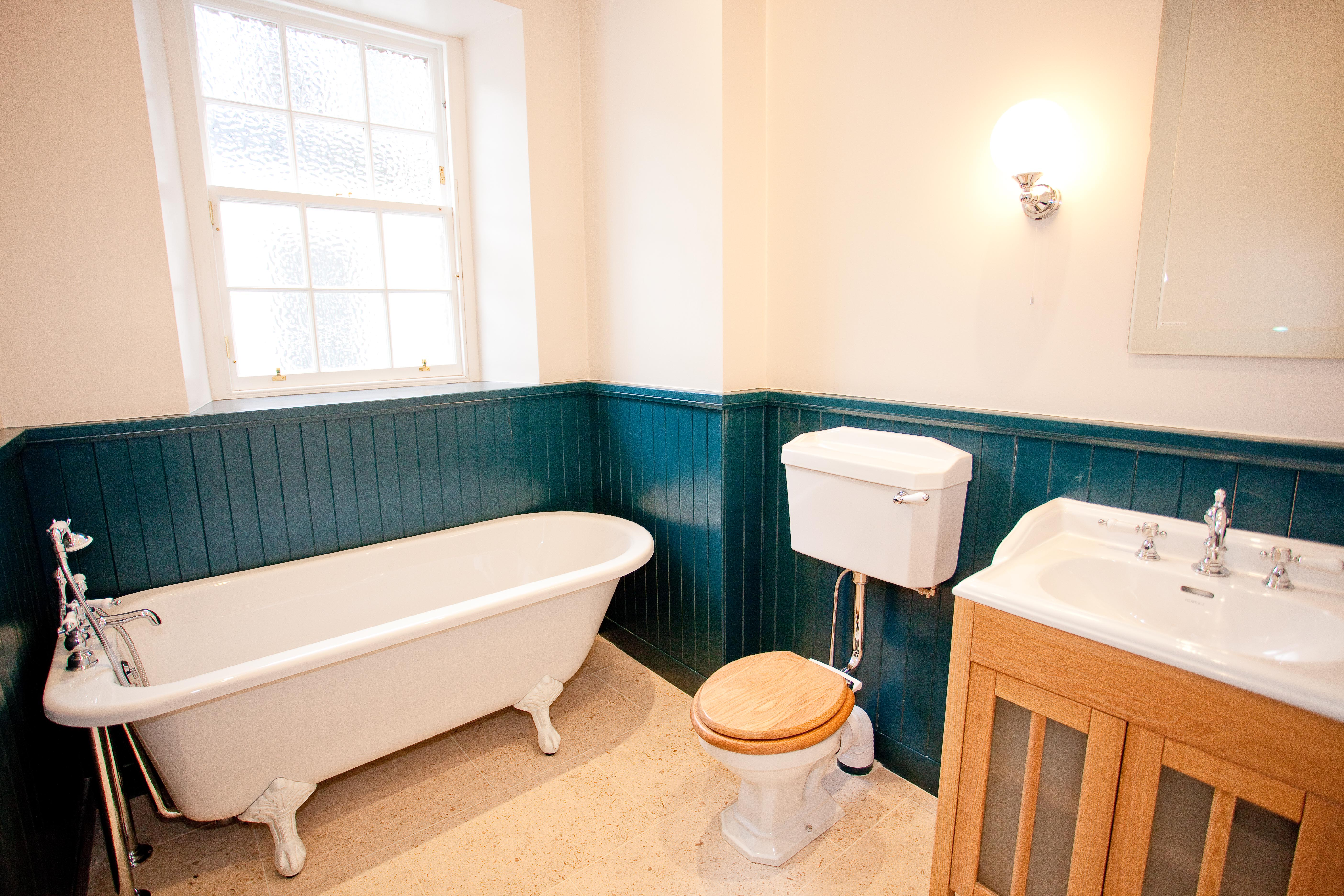 Traditional bathroom design edinburgh with painted wood panelling.