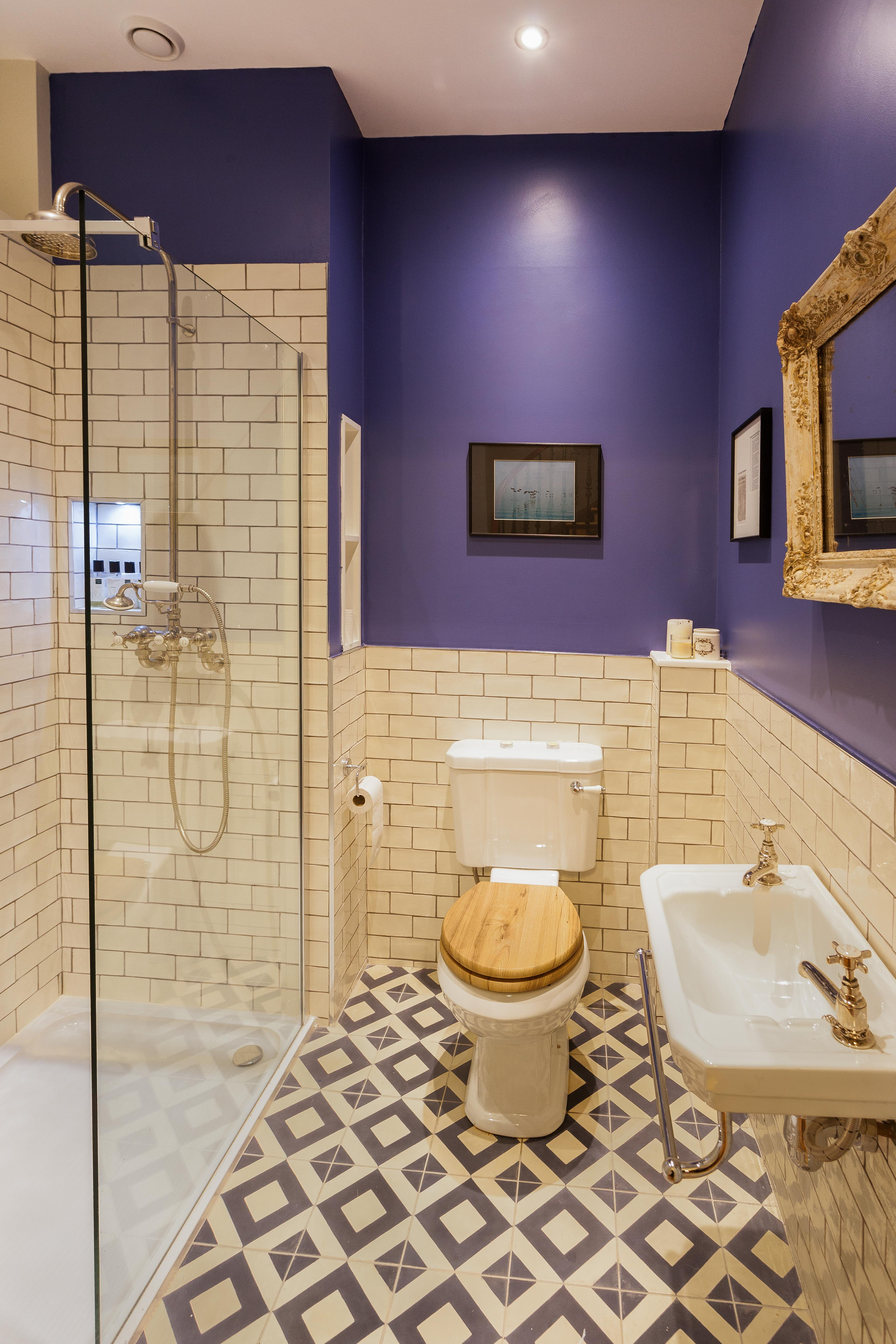 Edinburgh gold shower room with basin, toilet and exposed shower valve.