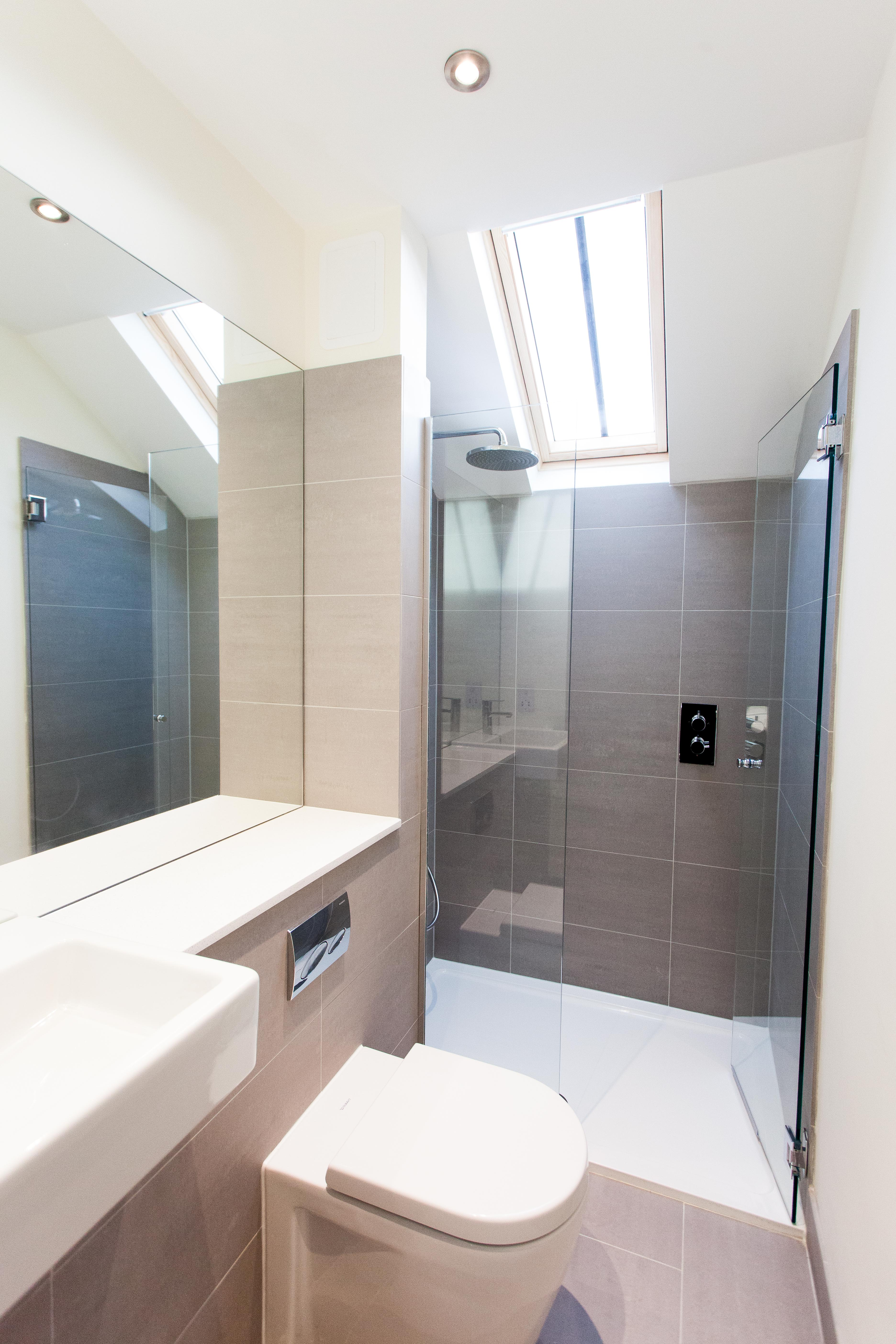 Modern Bathroom Wetroom shower cubicle with glass and dark tiles